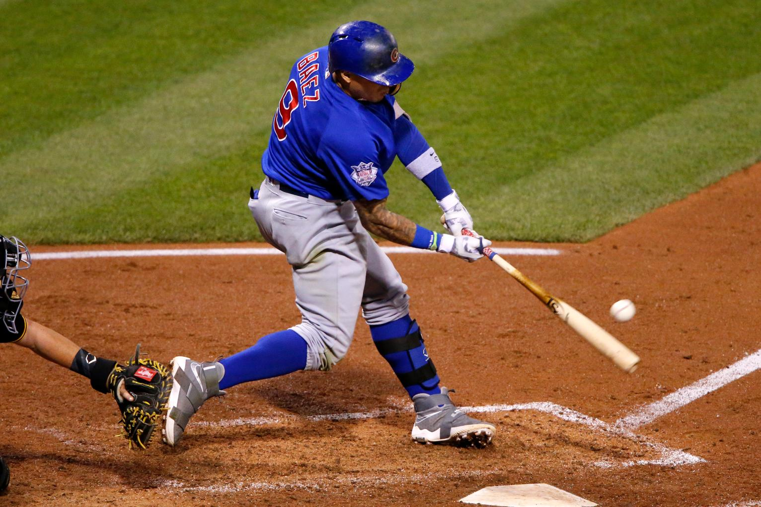 Cubs rout Pirates 12-2 for 100th win behind Baez's six ...