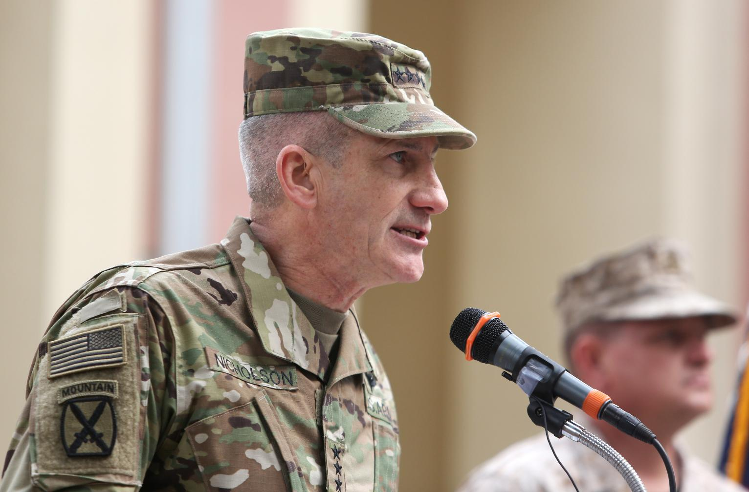 change in command of usnato forces in afghanistan world