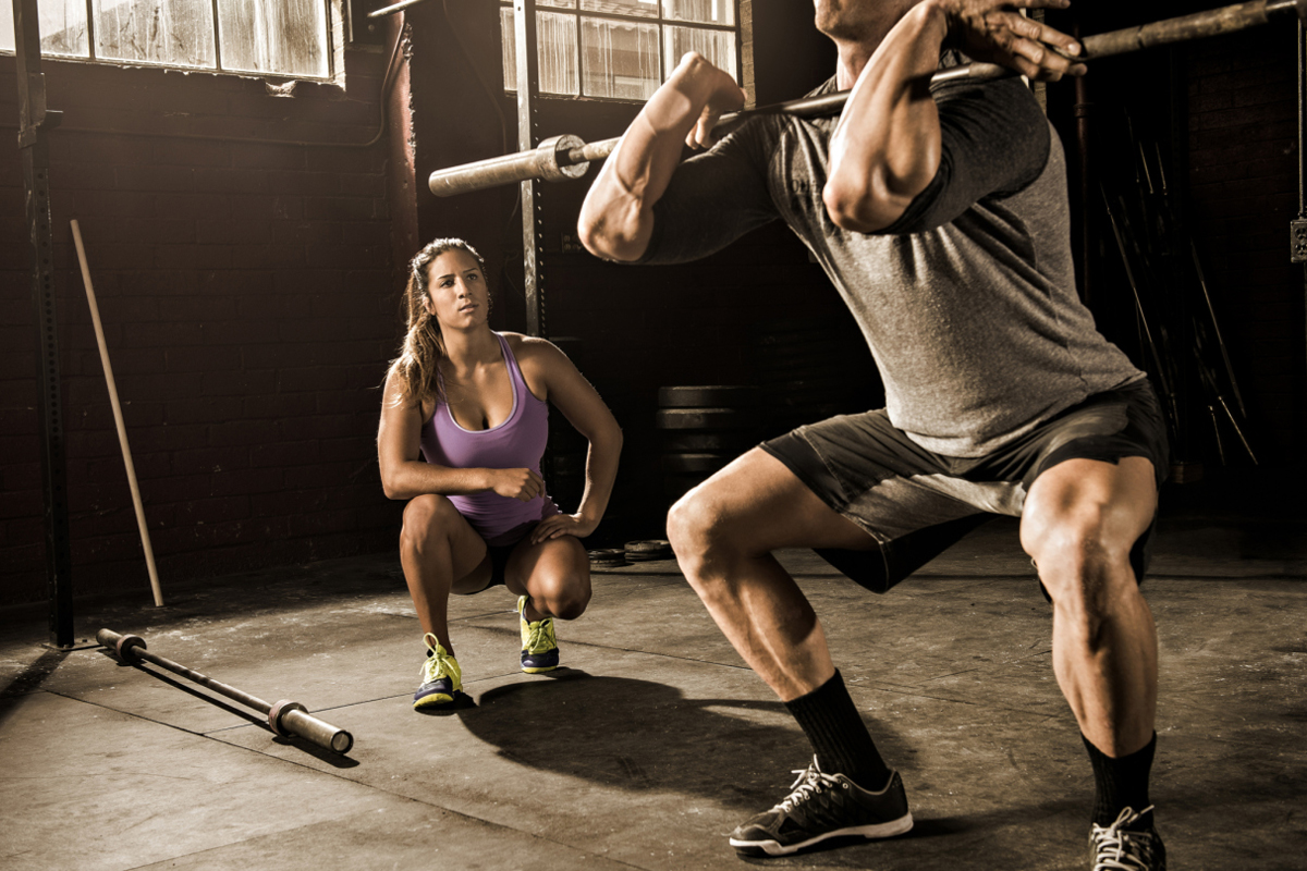 find a personal trainer squatting while client does a front squat with a barbell
