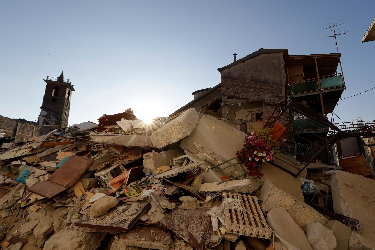 Bulldozers work to clear out Italy's quake-hit towns