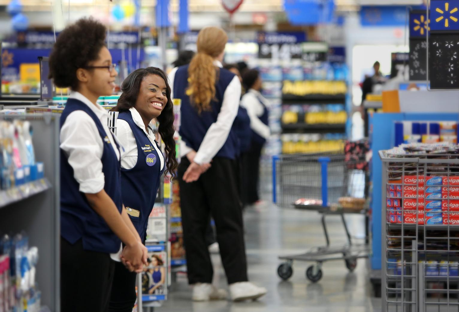 Wal Mart Brings Back Greeters At The Store Door Business
